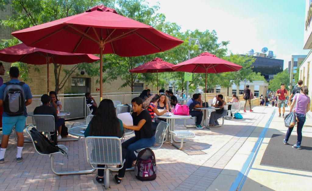 Students sitting at MC's outdoor seating located outside of the Campus Center (photo: Enori Atsu)