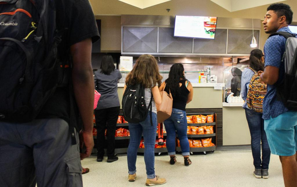 Students waiting in line to grab lunch at the MC Cafe
