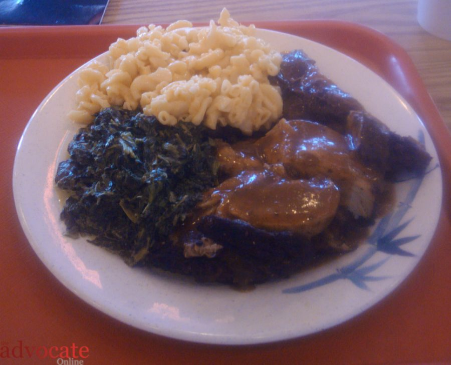 A plate of Jerk Chicken, Mac and Cheese and Creamed Spinach. is but one of the many dish combinations offered at Island Pride. -- Photo by: Matt Fleming