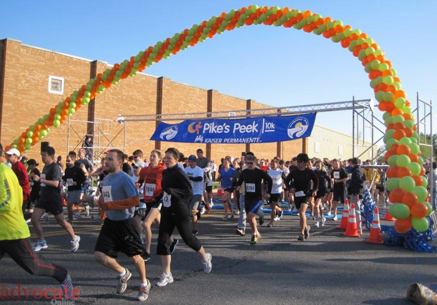 Joggers leave the start line at Redland Road in intervals of 500 people in order to spread out the masses. -- Photo by: Stacey Hollis