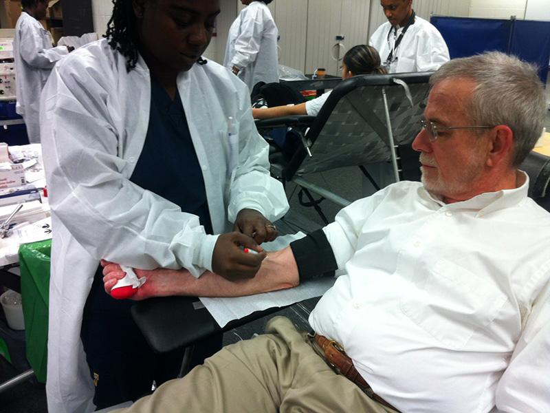 Paul+Halpine+prepares+to+give+blood