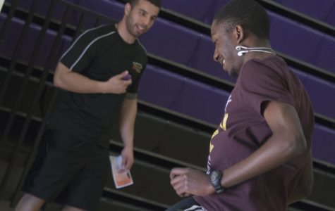 Patrick Cartagena (left) and Adrian Mullings running an obstacle course
