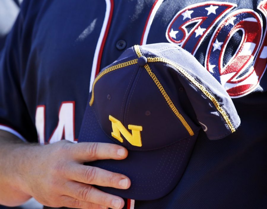 The Washington Nationals wore Navy hats before both games on Tuesday