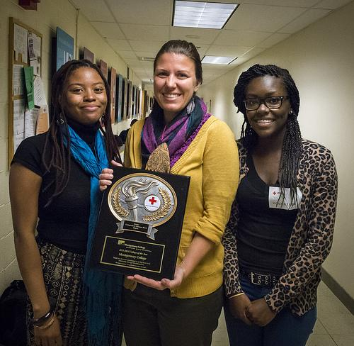 The Office of Student Life's staff proudly accepts Red Cross' award in behalf of blood donations
