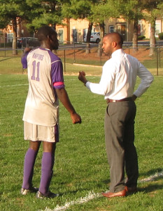 Freshman Gabriel Ndiave, 11 receives strategy instructions from head coach Pedro Braz. (Photo Credit: Kevin Ortiz)