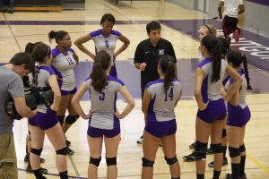 MC's women volleyball head coach, Amir Mafinejad, gives instructions during a timeout. (Photo Credit: Adriano Cassoma)