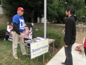 Activist Kenn Garrison argues against abortion while using Montgomery College to convey his message