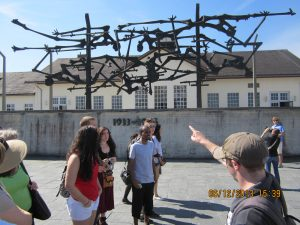 MC Study Abroad students listen to a lecture at Dachau German concentration camp (Photo Credit: Greg Malveaux).
