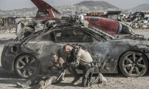 Diego Luna (left) and Matt Damon on the remains of Earth in Elysium (Photo Credit: The Guardian)