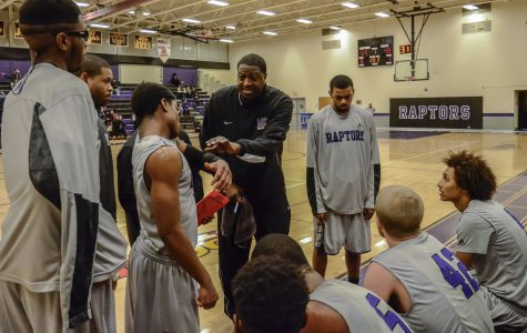 Head Coach James Bryson instructs his team during a timeout.