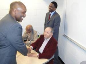 Derrick Douglass shakes hands with Airman First Lieutenant Floyd Collins alongside First Lieutenant Wylie W. Selden. (Photo Credit: Derrick Douglass)