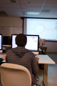 Student learning the skill for a technological course.