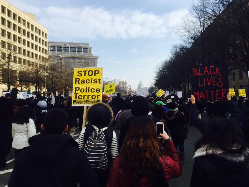 Protesters Marching Towards the Capitol (Photo Credit: Robin Smith)