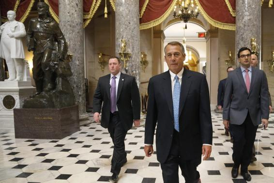 House Speaker John Boehner (R-OH) (2nd R) returns to his office after a visit to the House floor for procedural votes for legislation to fund the Department of Homeland Security at the Capitol in Washington, February 27, 2015. Credit: Reuters/Jonathan Ernst
