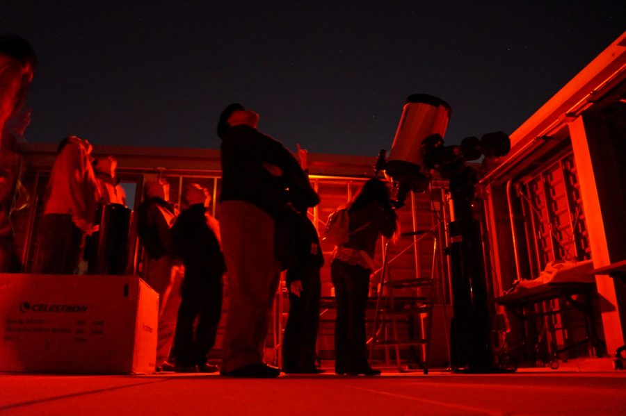 Stargazers look through the college's professional telescope on top of the Science Center. Photo Credit: Josue Arce