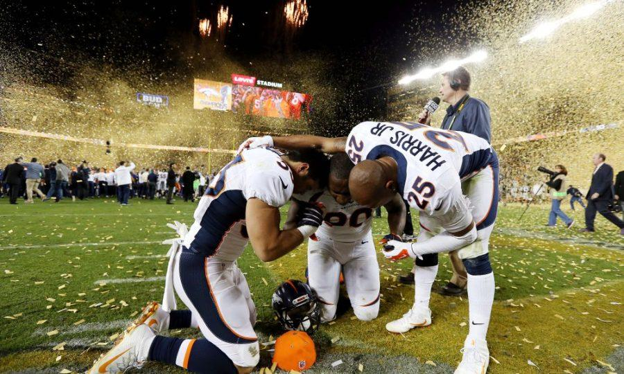 Feb 7, 2016; Santa Clara, CA, USA; Denver Broncos safety Shiloh Keo (33), defensive end Antonio Smith (90) and cornerback Chris Harris (25) react after beating the Carolina Panthers in Super Bowl 50 at Levi's Stadium. Mandatory Credit: Matthew Emmons-USA TODAY Sports ORG XMIT: USATSI-245820 ORIG FILE ID:  20160207_pjc_se2_288.JPG