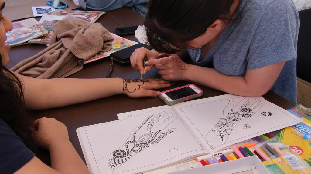 Henna being done on a student at the artw@lk (photo: Nikole Coates)