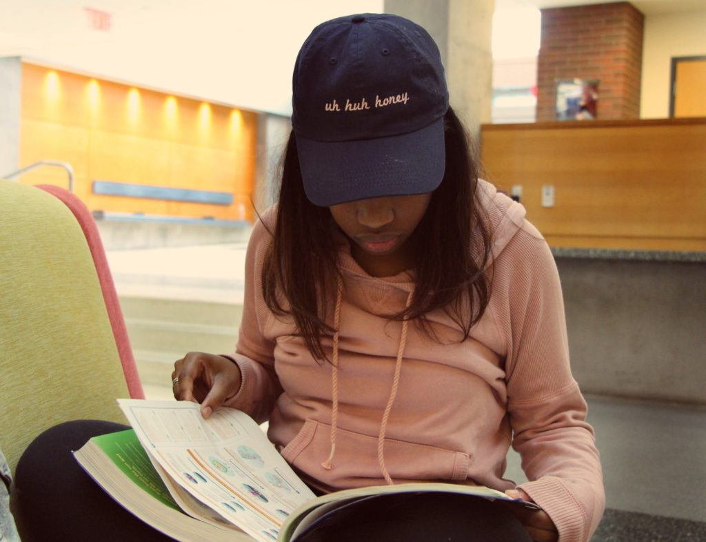 Breanna English studying from her textbook for a future Biology exam (photo: Sara Monterroso)