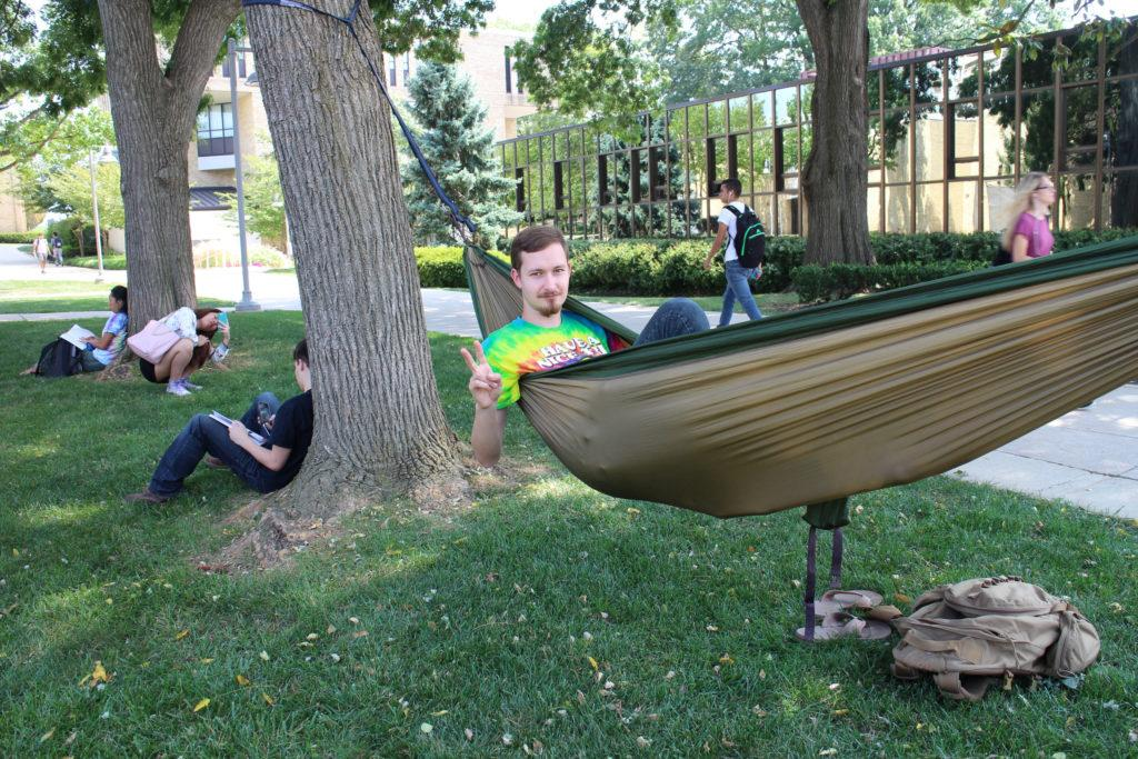 Not something you see everyday--student opts for a hammock hung on trees in front of MC's student service building for a relaxing nap. (photo: Enori Atsu)