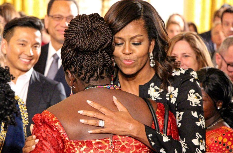 Pictured+above+is+the+First+Lady+embracing+one+of+the+many+young+girls+who+attended+the+premiere.+She+made+sure+every+single+one+of+them+got+a+hug+from+her+that+day.+%28photo%3A+Sara+Monterroso%29