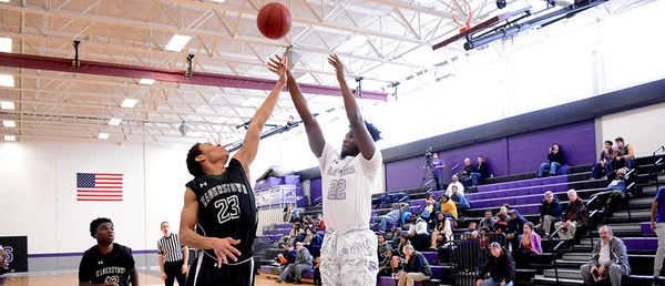 Shekinah Mondoua shoots a jumper under pressure - Photo courtesy of Montgomery College Athletics website
