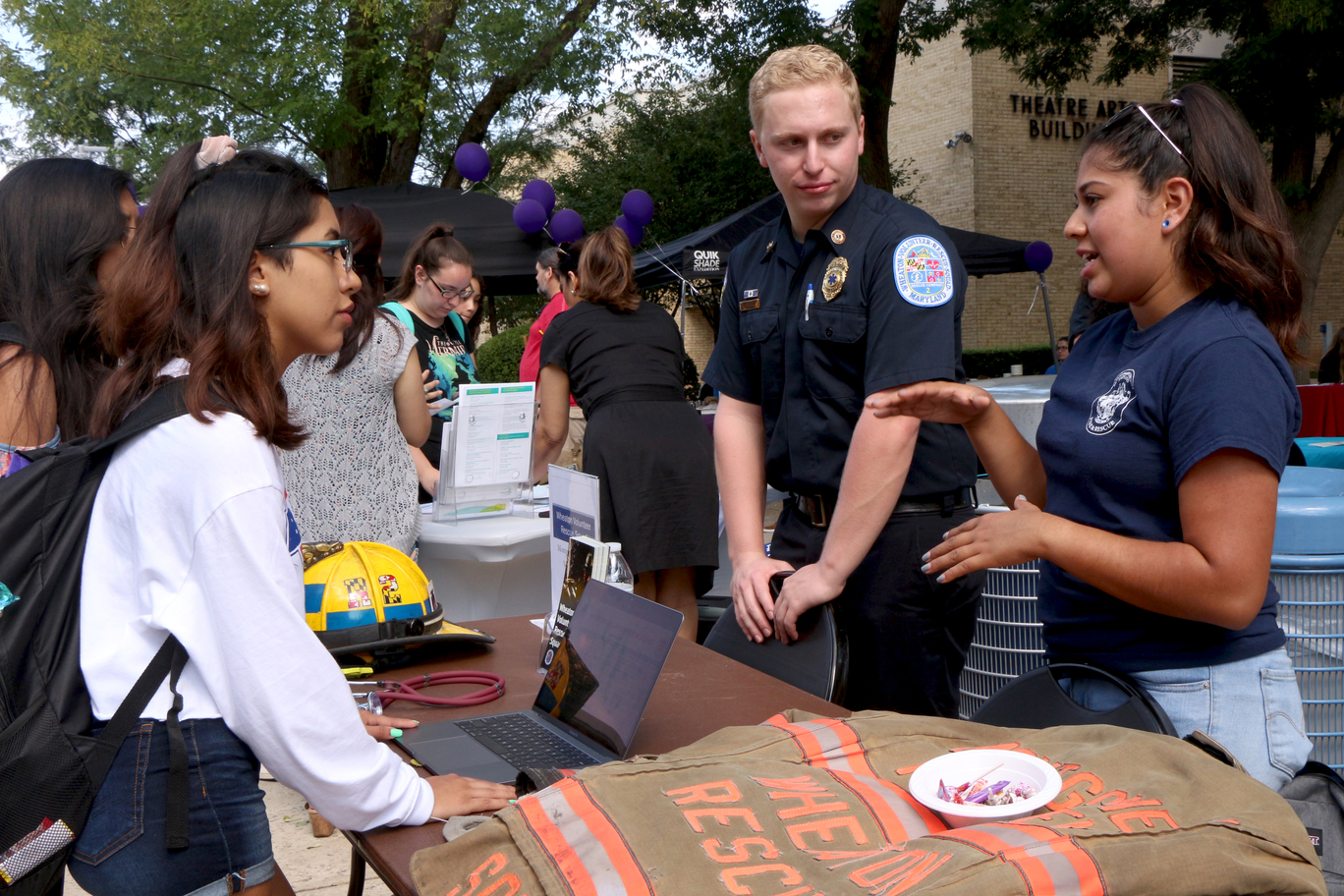 Left to right: Sasha Laredo, a pre-nursing freshman, discusses training opportunities with members of the Wheaton Volunteer Squad during the Student Life Give & Get Help Fair at Montgomery College Rockville Campus Sept. 19. The Wheaton Volunteer Squad offers free training to EMT and fire fighter volunteers.