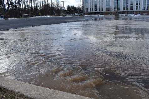 Water flowing over parking lot 11 on Jan. 25.