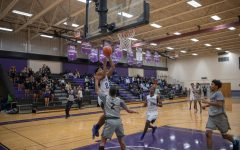 #2 Tyran Crawford, shooting guard, going up for an easy layup over #2 Aaron Castro, point guard.