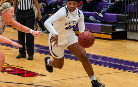 Jordan Odom, point guard, driving to the lane.
