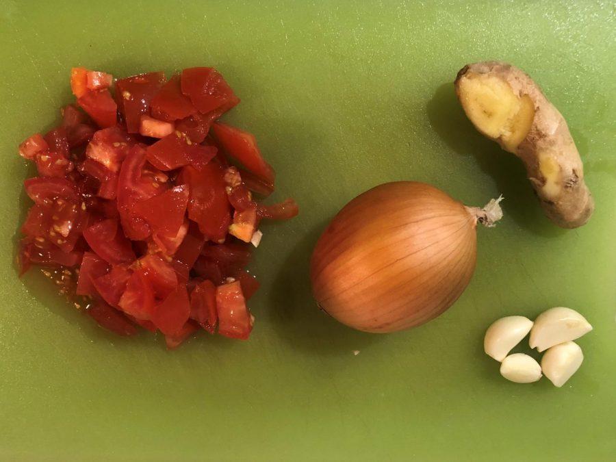 Medium+sized+onion%2C+chopped+tomato%2C+four+cloves+garlic+and+ginger.