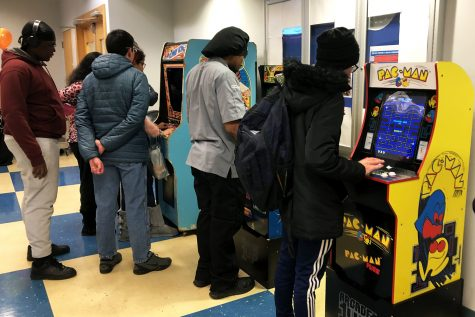 Students play classic arcade games at MC Raptor Week