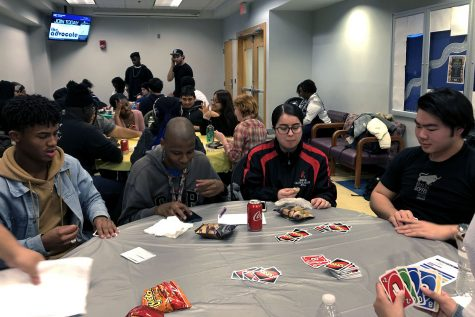 Students playing Uno at MC Raptor Week