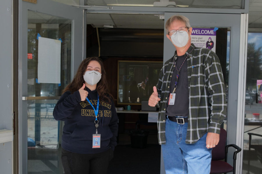Erin Sigmon and volunteer Philip Walsh at Montgomery College. Photo by Michael Hyman